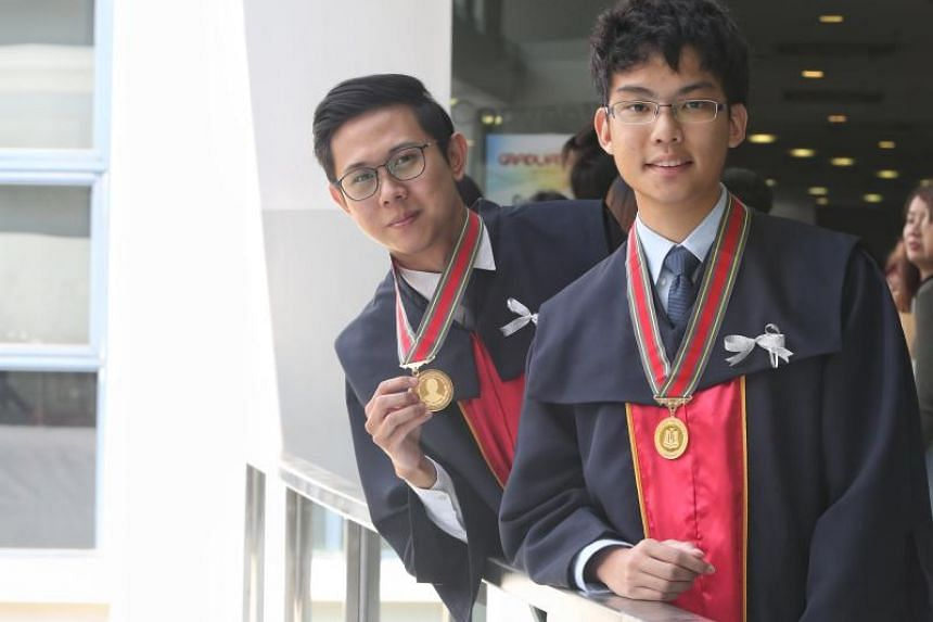 Sim Rong Xing (left) and Solomon Tan at Temasek Polytechnic's graduation opening ceremony on May 3. They were the recipients of the Tay Eng Soon Gold Medal and the Lee Kuan Yew Award respectively.