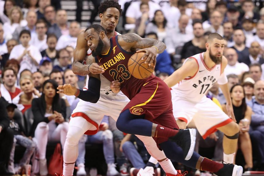 Cleveland forward LeBron James driving to the basket against Toronto guard DeMar DeRozan in game two of the Eastern Conference semi-finals of the 2018 NBA Playoffs at Air Canada Centre on May 3, 2018. The Cavaliers won 128-110.