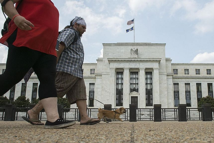 """The US Federal Reserve's policy-making Federal Open Market Committee reaffirmed that it expected to continue on a path of """"further gradual increases"""" in the benchmark lending rate."""