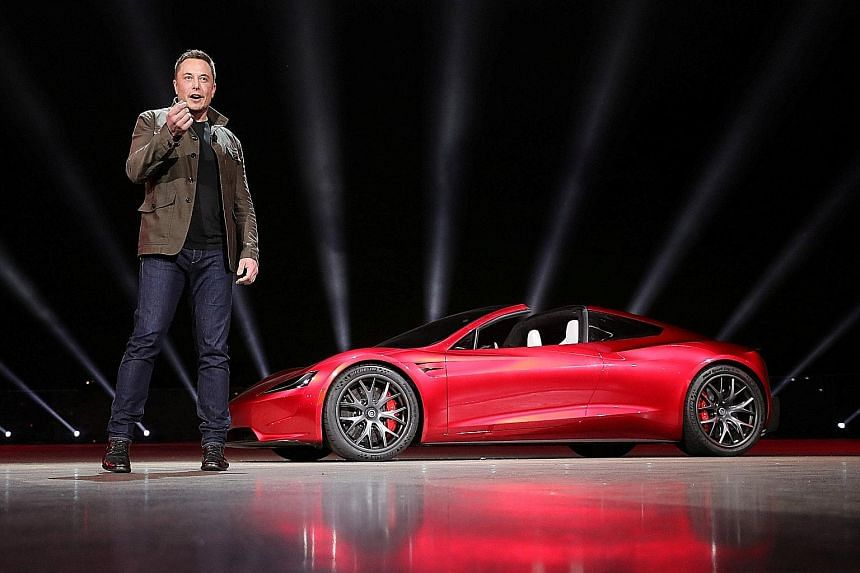Tesla CEO Elon Musk presenting the Roadster 2 on Nov 6 last year. More than two years ago, he unveiled Tesla's first mass-market car, but he has pushed back Model 3 manufacturing targets several times, hence limiting the amount of money coming in fro