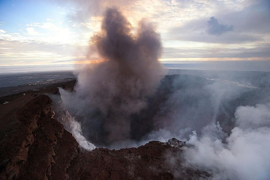 Smoke rising from the crater of Pu'u 'O'o, a volcanic cone in the eastern rift zone of the Kilauea Volcano in Hawaii, on Wednesday. The crater's floor collapsed on Tuesday and since then it has kept eroding its walls and generating huge explosions of