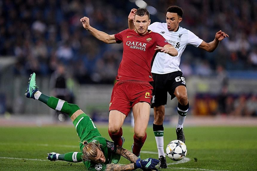 Roma striker Edin Dzeko being brought down by Liverpool goalkeeper Loris Karius in the second half but he was wrongly ruled offside. Roma were denied another penalty when defender Trent Alexander-Arnold (No. 66) appeared to handle the ball in the box
