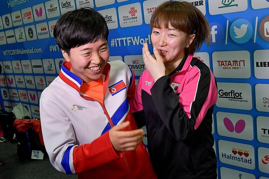 Suh Hyo Won of South Korea (far right) and Kim Song I of North Korea sharing a light moment after a news conference in Halmstad, Sweden, yesterday.