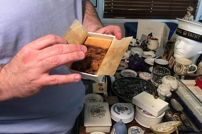 Collector John Hoatson shows a piece of Princess Diana's wedding cake from his collection of royal family memorabilia at his home in Pompano Beach, Florida, US, on April 21, 2018.