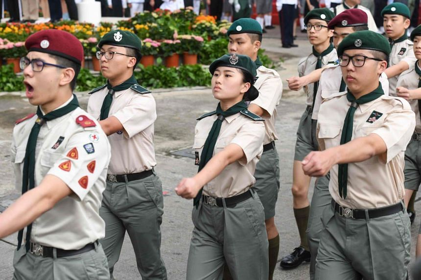 Members of a military-style youth group use the British style quick march as they take part in an annual flag raising ceremony in Hong Kong, on May 4, 2018.