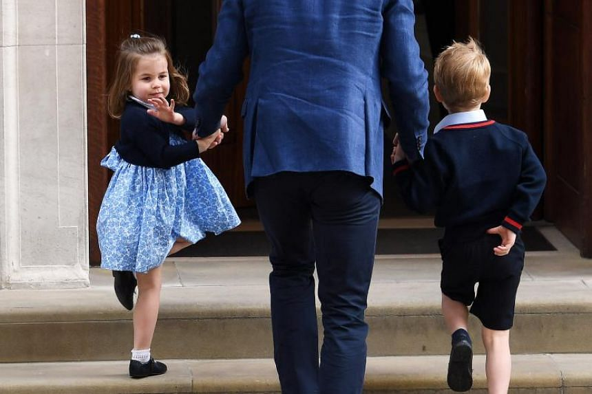 Britain's Prince William, Duke of Cambridge (centre) and his children Prince George (right) and Princess Charlotte at the Lindo Wing at St. Mary's Hospital in London on April 23, 2018.