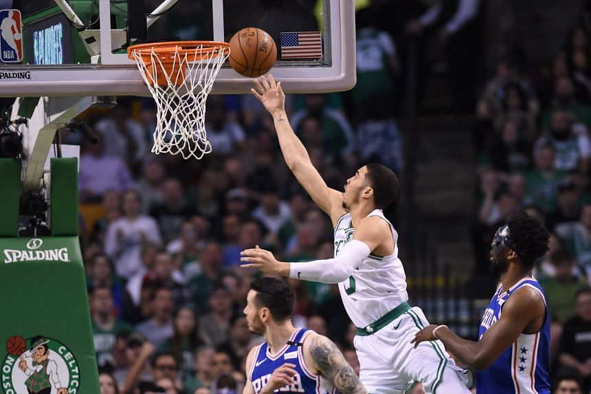 Boston Celtics forward Jayson Tatum (0) shoots past Philadelphia 76ers guard JJ Redick (17) during the first half in game two of the second round of the 2018 NBA Playoffs.