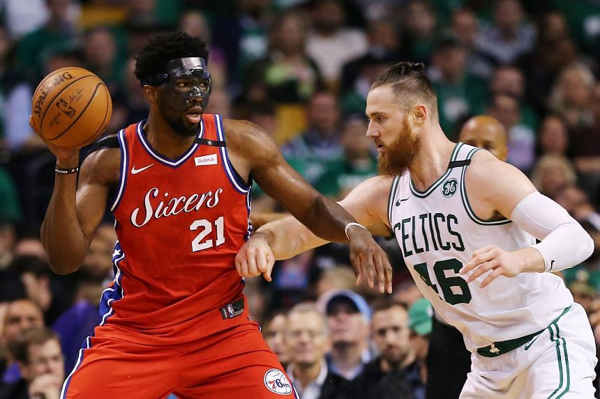 Aron Baynes #46 of the Boston Celtics defends Joel Embiid #21 of the Philadelphia 76ers during the second half of Game One in Round Two of the 2018 NBA Playoffs, on April 30, 2018.