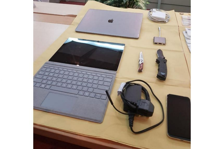 Police recovered one mobile phone; one Macbook; one Microsoft Surface Pro; one foldable knife; one flick knife; and substances believed to be controlled drugs from the 36-year-old man's hotel room.