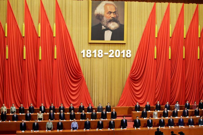 Officials singing the national anthem at an event commemorating the 200th birth anniversary of Karl Marx, in Beijing, China, on May 4, 2018.