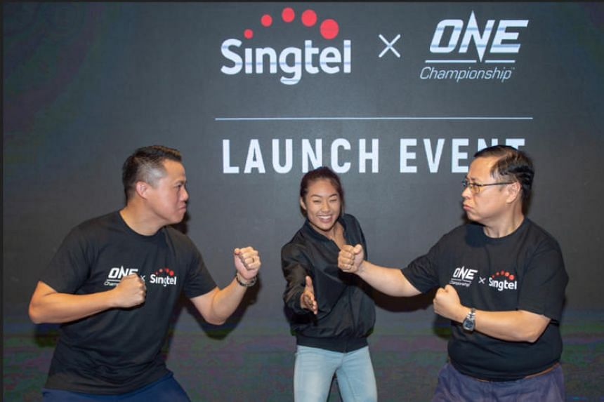 (From left) One Championship's chief financial officer Teh Hua Fung, One atomweight champion Angela Lee and Arthur Lang, CEO of Singtel's International Group, at the MOU signing between Singtel and One.