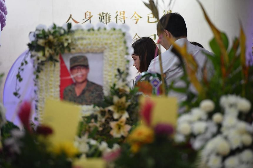 Friends and family members of the late Corporal First Class Dave Lee gather at the wake held at CFC Lee's home in Jurong East.