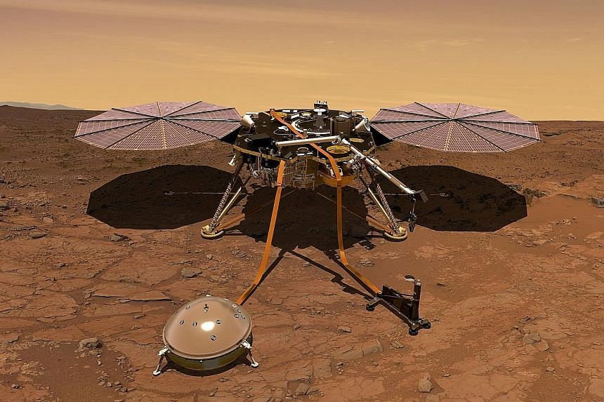 An artist's rendition of Nasa's InSight probe operating on the surface of Mars. The unmanned spacecraft is due to lift off from Vandenberg Air Force Base in California today and should land on the Red Planet on Nov 26.