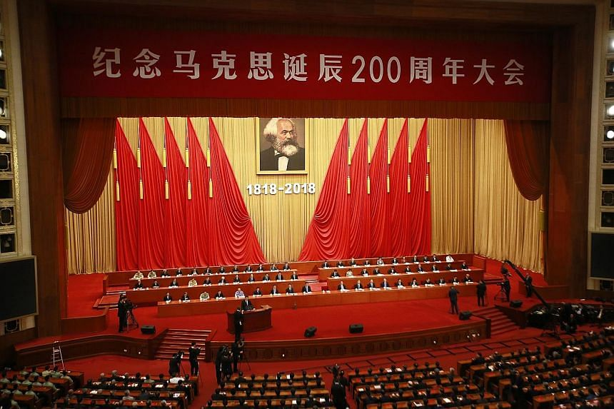 Chinese President Xi Jinping delivering his speech at an event celebrating the 200th anniversary of Karl Marx's birth. His speech came near the end of a week-long propaganda blitz aimed to show that Marxism remains relevant.