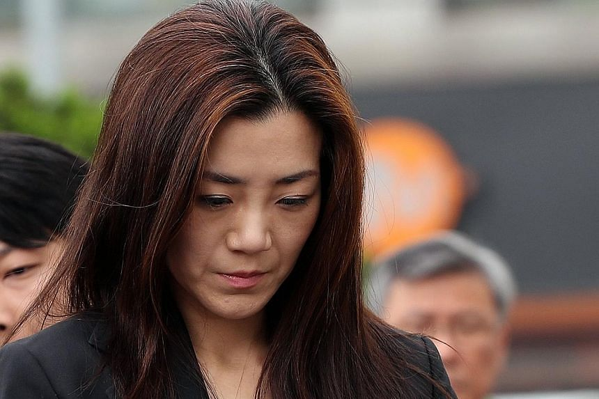 Ms Cho Hyun Min has been accused of throwing a drink at people at a business meeting last month.
