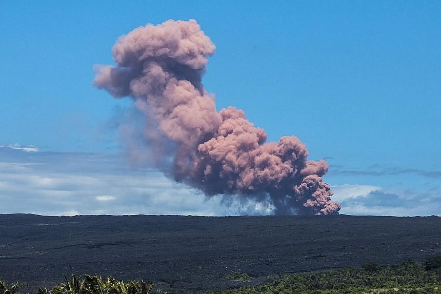 """An ash plume rising above the Kilauea Volcano on Hawaii's Big Island on Thursday. The volcano erupted after a series of earthquakes over the last couple of days, including a 5.0 tremor. Following the eruption, the authorities warned of subsequent """"la"""