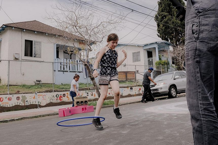 """In a play street in Boyle Heights, plastic """"wobbles"""" become building blocks as children take to the road for fun (above)."""