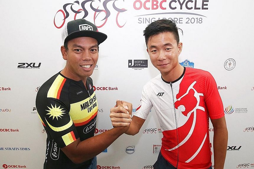 Above: Army regular Toh Kok Chai, 51, signs up for the ST Run's 18.45 km event at the ST Run booth at the OCBC Cycle Weekend Market. From far left: Malaysia team captain Anuar Manan and Singapore team captain Goh Choon Huat at the OCBC Cycle Speedway