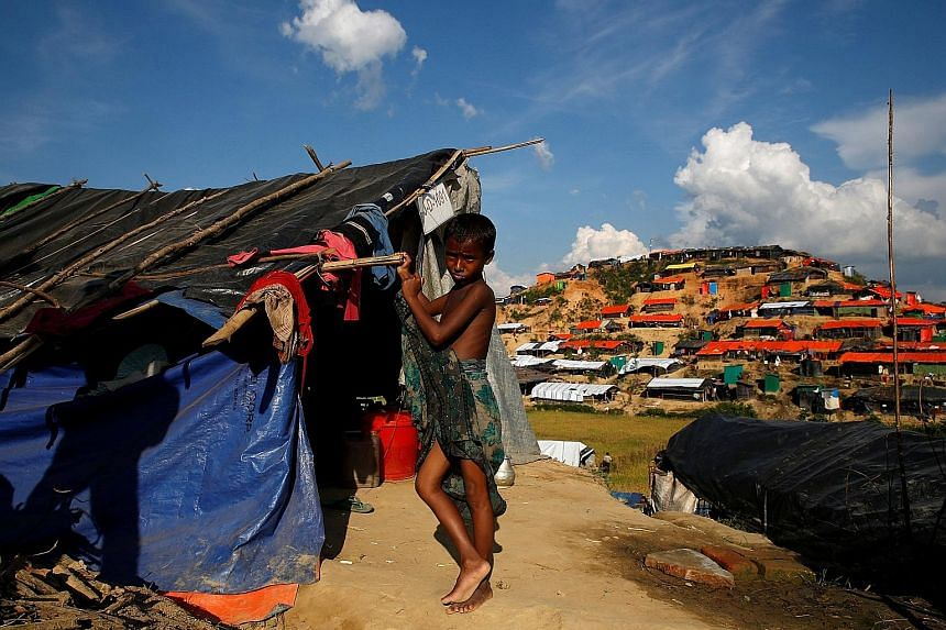 A Rohingya refugee in Palong Khali refugee camp, near Cox's Bazar, Bangladesh. Shelters, temporary housing and other amenities are being prepared for Rohingya who may wish to return to Rakhine. Larger Myanmar businesses have also contributed to infra
