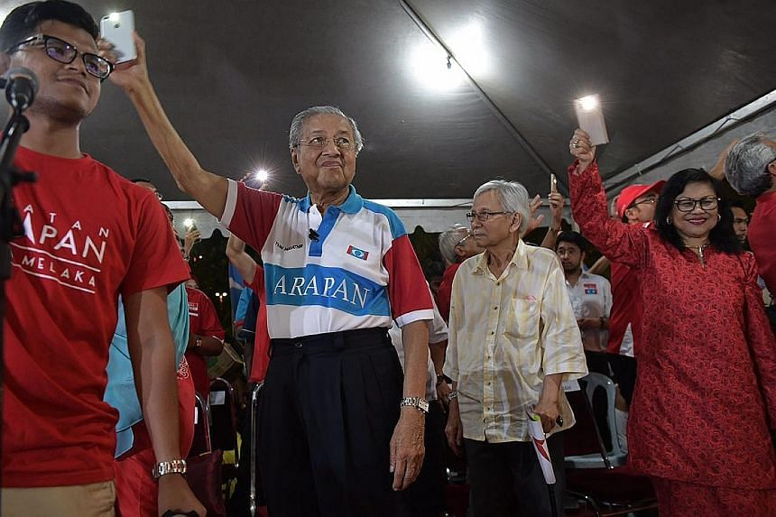 Dr Mahathir Mohamad and former ministers Daim Zainuddin and Rafidah Aziz at the rally in Mutiara, Melaka, yesterday. Their appearance drew Malaysians of all races and ages.