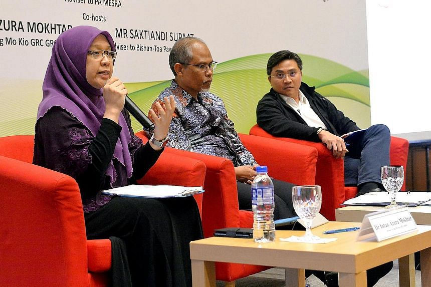 Mr Masagos at a Malay Activity Executive Committees Council dialogue with MPs Intan Azura Mokhtar and Saktiandi Supaat earlier this year. Mr Masagos Zulkifli participating in a water rationing exercise at a National University of Singapore residentia