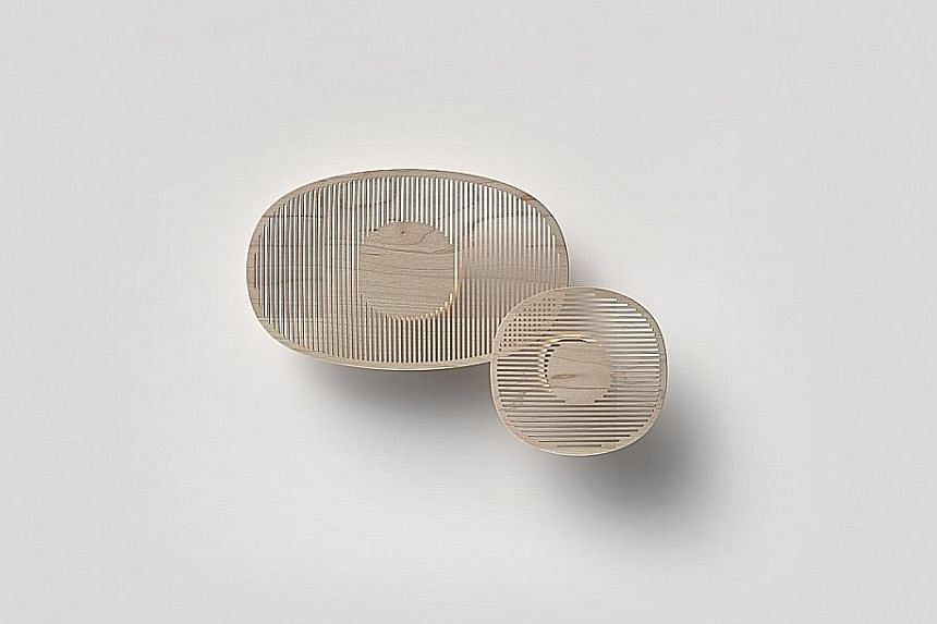 The Exchanged Forms exhibition featured works such as Singapore designers Cheryl Ho's lamps (above), inspired by light filtering through Japanese windows, and Lee Hsiao Fong's vase , which pays homage to the Japanese uchiwa fan; and Japanese designer Kant
