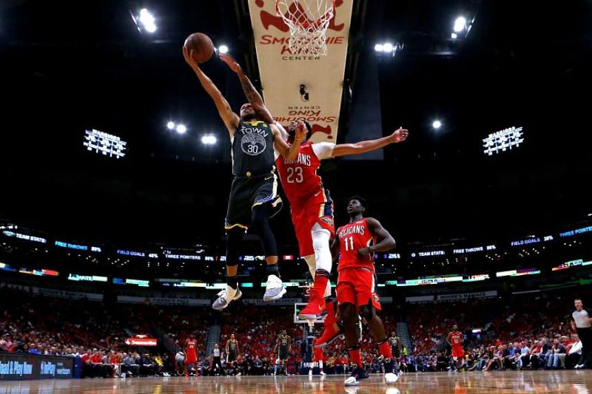 Stephen Curry of the Golden State Warriors is fouled by Anthony Davis of the New Orleans Pelicans during the 2018 NBA Playoffs at the Smoothie King Center on May 4, 2018.