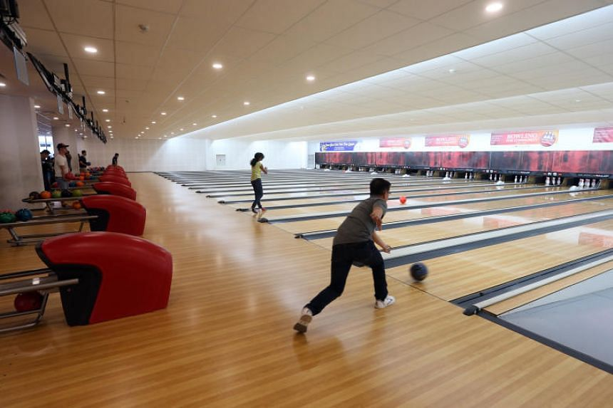 "The CC will be the first in Singapore to feature a bowling alley and a ""vending machine cafe"", where residents can purchase ready-to-eat meals."