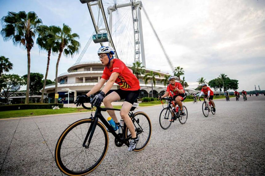 Participants of the OCBC Cycle 2017 riding past the Singapore Flyer.