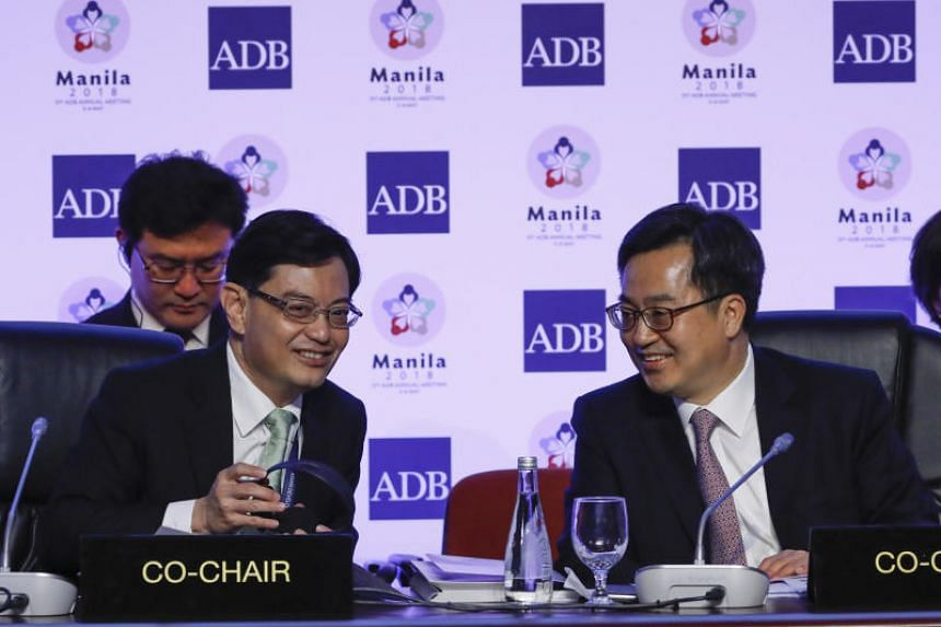 Finance Minister Heng Swee Keat (left) said that the country's expenditures would continue to rise because of growing infrastructure needs and an ageing population.