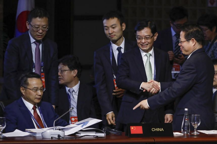 Finance Minister Heng Swee Keat (second from right) said no country will benefit from a trade war - not even the countries that started it.