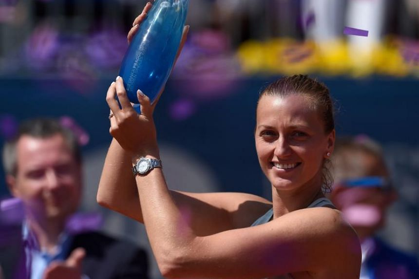 Petra Kvitova of the Czech Republic celebrates with the trophy after defeating Romania's Mihaela Buzarnescu in their final tennis match at the WTA Prague Open on May 5, 2018 in Prague.