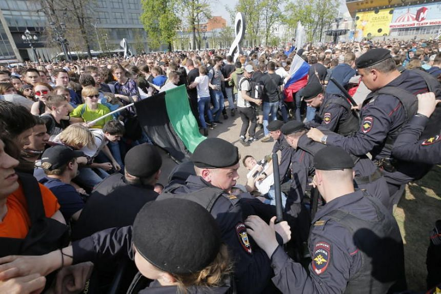 Russian police arrest a participant of a liberal opposition rally organised by Alexei Navalny in Moscow, on May 5, 2018.