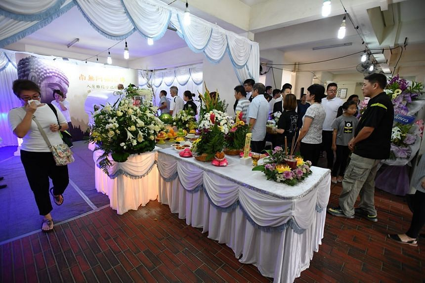Friends and family members of the late Corporal First Class Dave Lee gathered at the wake held at CFC Lee's home in Jurong East.