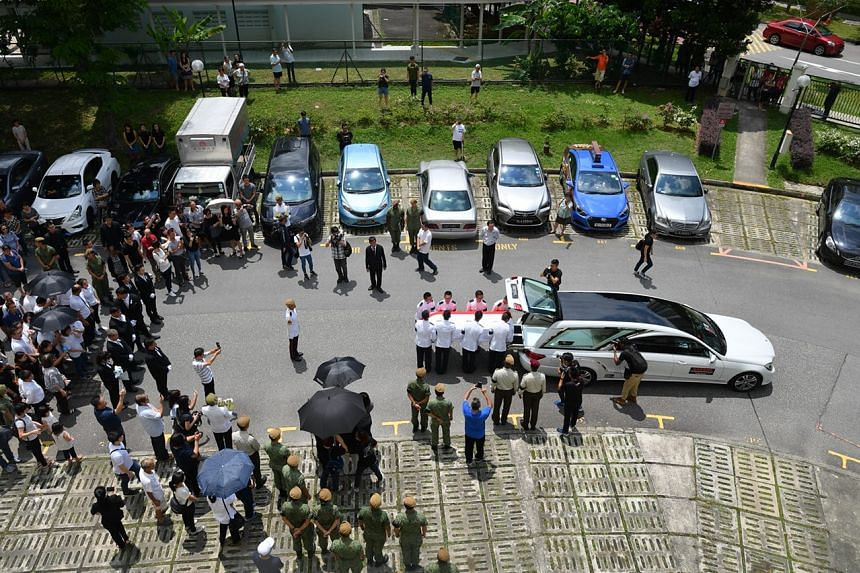 The cortege leaving the wake after family, friends and army officers paid their last respects to Corporal First Class Dave Lee Han Xuan.