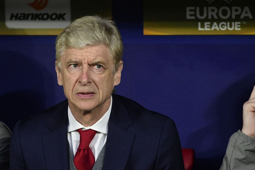 Wenger looks on before the Europa League semi-final second leg match against Atletico Madrid.
