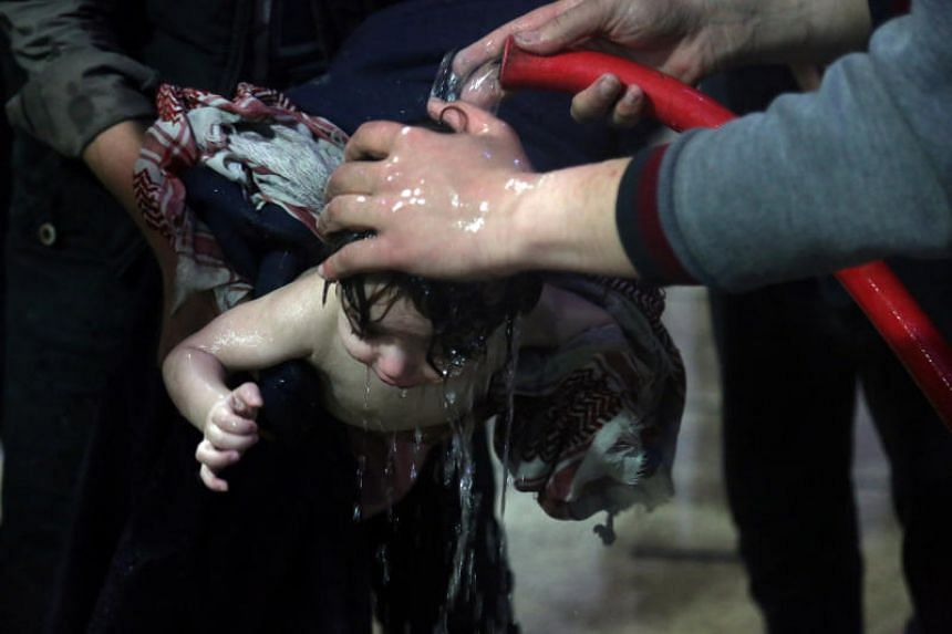 A child is treated in a hospital in Douma, eastern Ghouta in Syria, after what a Syria medical relief group claims was a suspected chemical attack on April, 7, 2018.