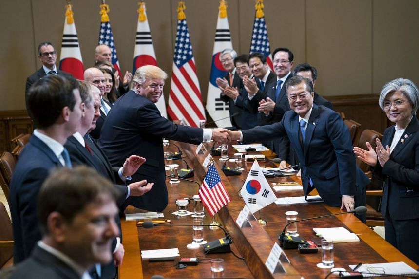 Trump and Moon shake hands during a bilateral meeting at the Blue House in Seoul, on Nov 7, 2017.