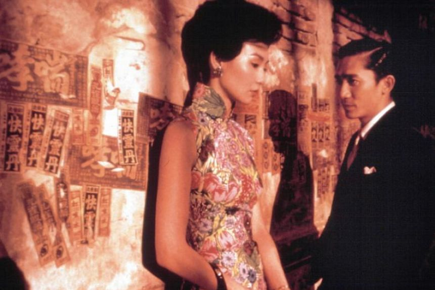 In the mood for hate: Social media users are fighting over if it's okay for non-Chinese people to wear qipao. Actress Maggie Cheung in one of the many cheongsams she wore for movie In The Mood For Love, with Tony Leung Chiu Wai.