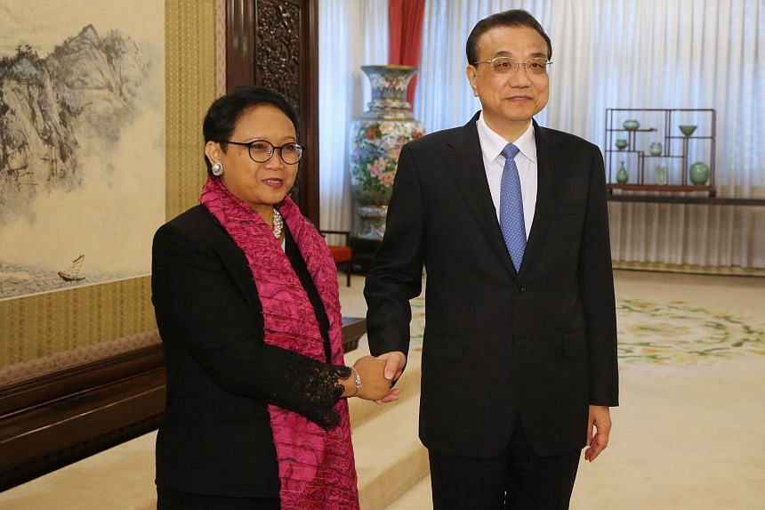 File photo of Indonesia's Foreign Minister Retno Marsudi (left) with China's Premier Li Keqiang in Beijing, on Feb 9, 2018.