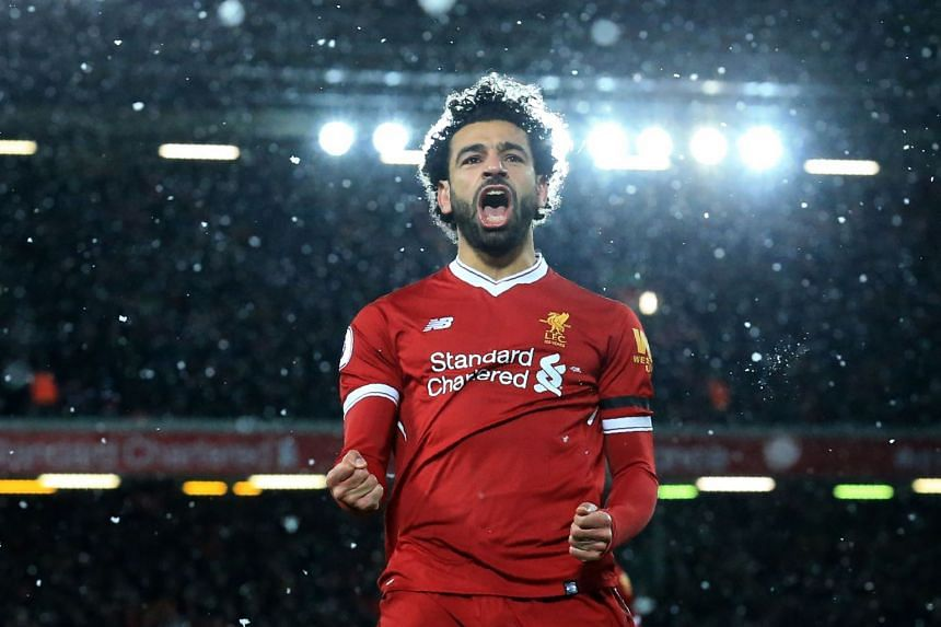 Liverpool's Egyptian midfielder Mohamed Salah celebrates after scoring the fourth goal during the English Premier League football match against Watford on March 17, 2018.