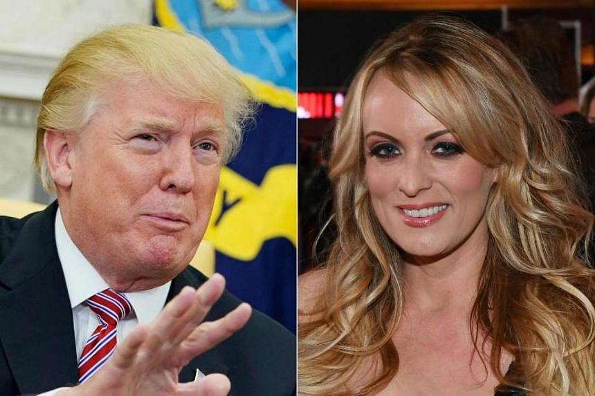It was not immediately clear when US President Donald Trump (left) learned of the payment to adult-film actress Stormy Daniels.