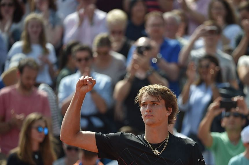 Zverev celebrates after winning against South Korea's Hyeon Chung.