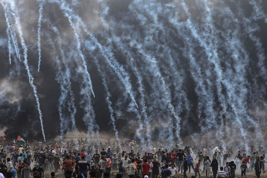 Israeli army soldiers fire tear-gas at Palestinians protesters during clashes on May 4, 2018.