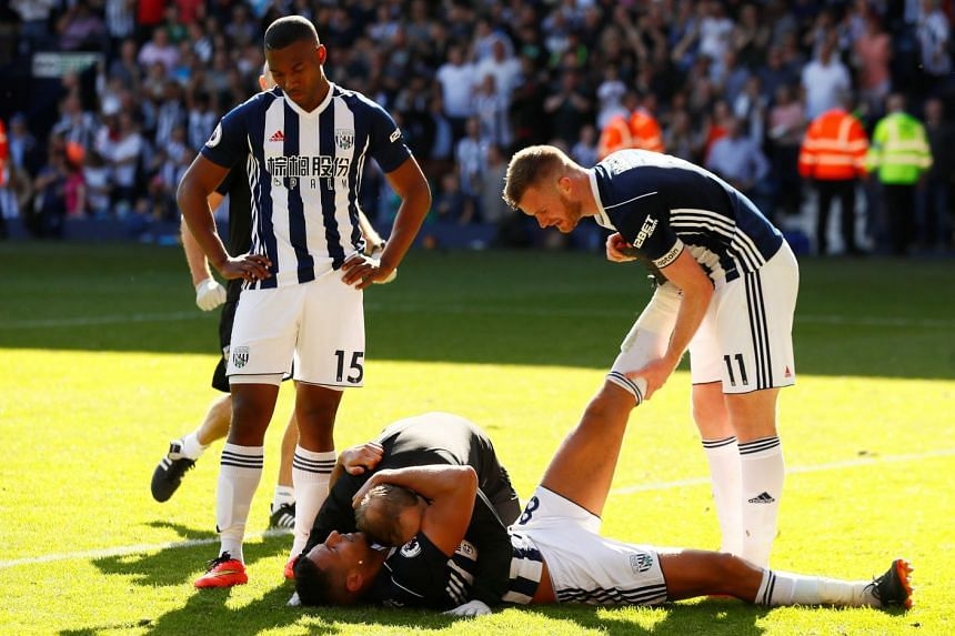West Bromwich Albion's Jake Livermore celebrates scoring with team mates.