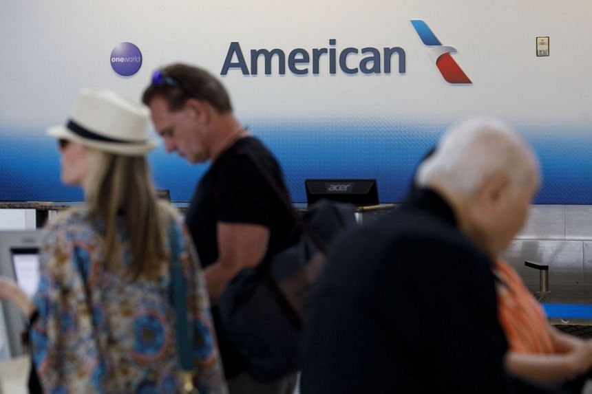 Travellers check-in at Dallas-Fort Worth International Airport with American Airlines.