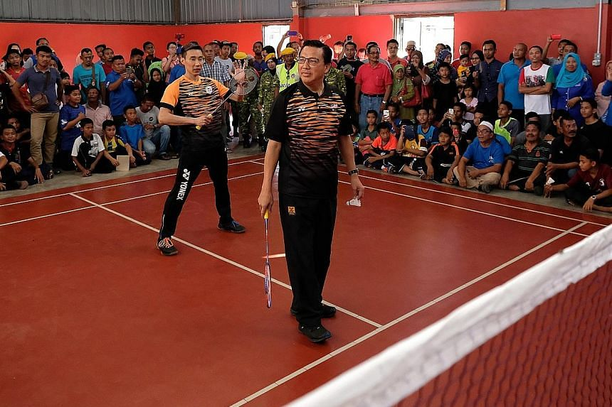 BN candidate for Bentong Liow Tiong Lai (foreground) with badminton star Lee Chong Wei during a friendly match in Bentong on Wednesday.