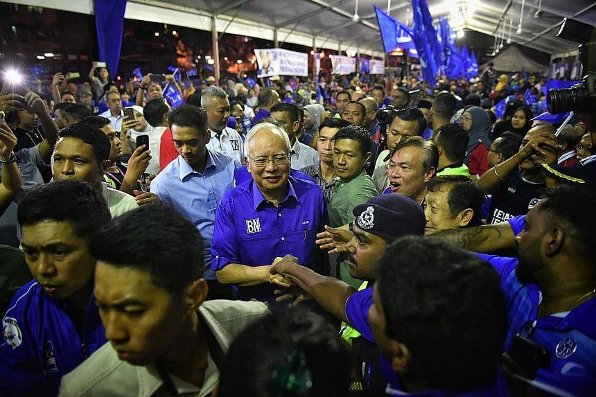 Prime Minister Najib Razak at a rally in Gombak Setia, Kuala Lumpur, last Tuesday. In his campaign appearances, he has focused on reaching out to the party machinery, community leaders and captains of industry.
