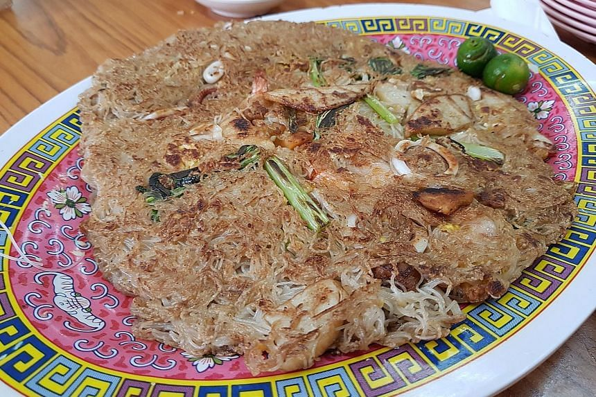 Chao tah bee hoon (top) exudes a heady aroma, while the deep-fried kailan (above) comes with a generous lashing of pork floss.