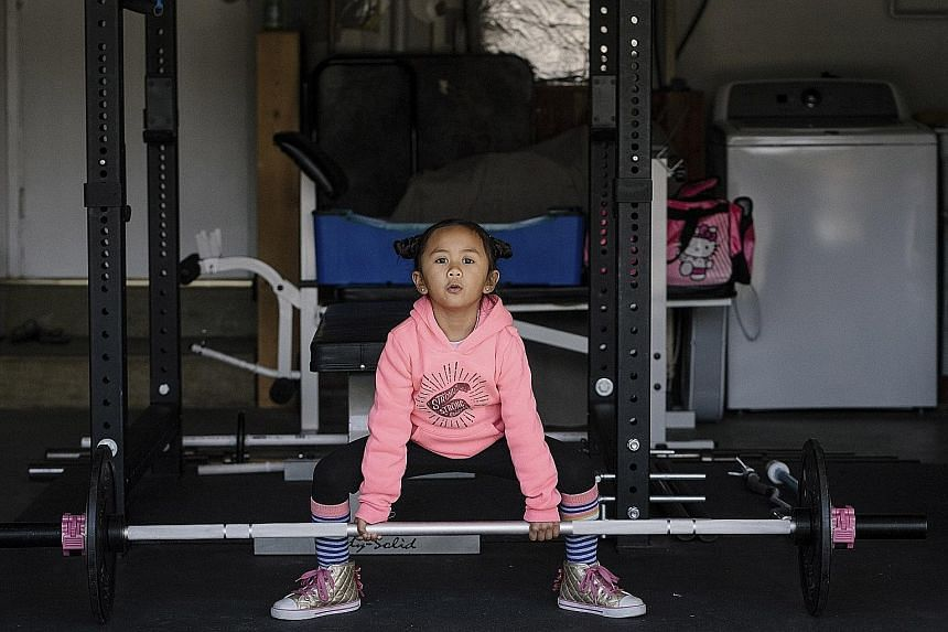 Luma Valones (above), now five, started powerlifting when she was three and 11-year-old Etta Nichols (left) has set 12 new American records in the sport.